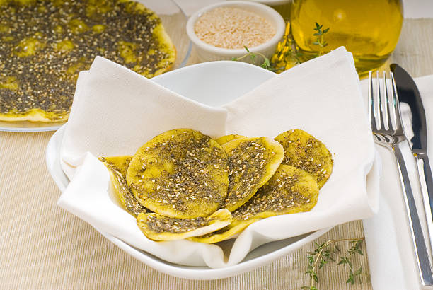 lebanese manouche or manoushe lebanese manouche or manoushe ,lebanese pizza with thyme and sesame seeds,zaatar, and extra virgin olive oil on top zaatar spice stock pictures, royalty-free photos & images
