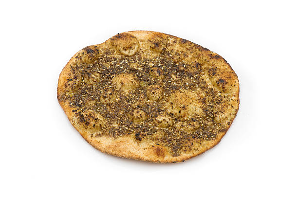 lebanese Manoushe , Baked bread of thyme lebanese Manoushe , Baked bread of thyme  zaatar spice stock pictures, royalty-free photos & images