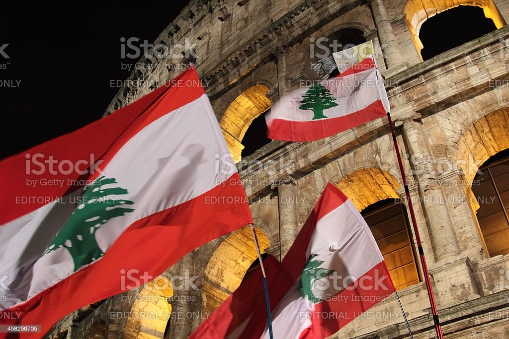 Lebanon flags at Colosseum during Stations of the Cross stock photo