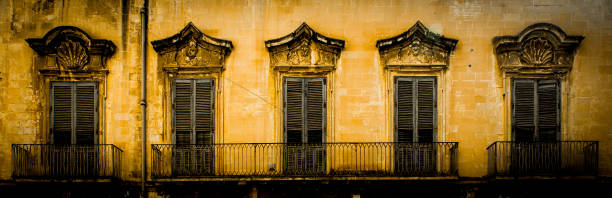 Lecce, Italy - Old windows in baroque style stock photo