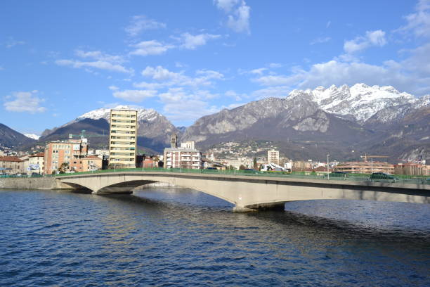 Lecco lakefront, the mountain Resegone, the new bridge  and the lake Como in a sunny day. stock photo