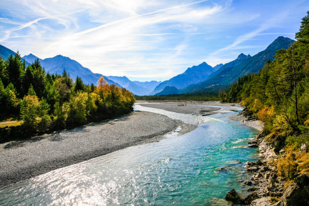 Lechriver at autumn, near Forchach, Lechtaler Alps, Tirol, Austria Lechriver with view of the Lechtaler Alps, Tirol, Austria riverbank stock pictures, royalty-free photos & images