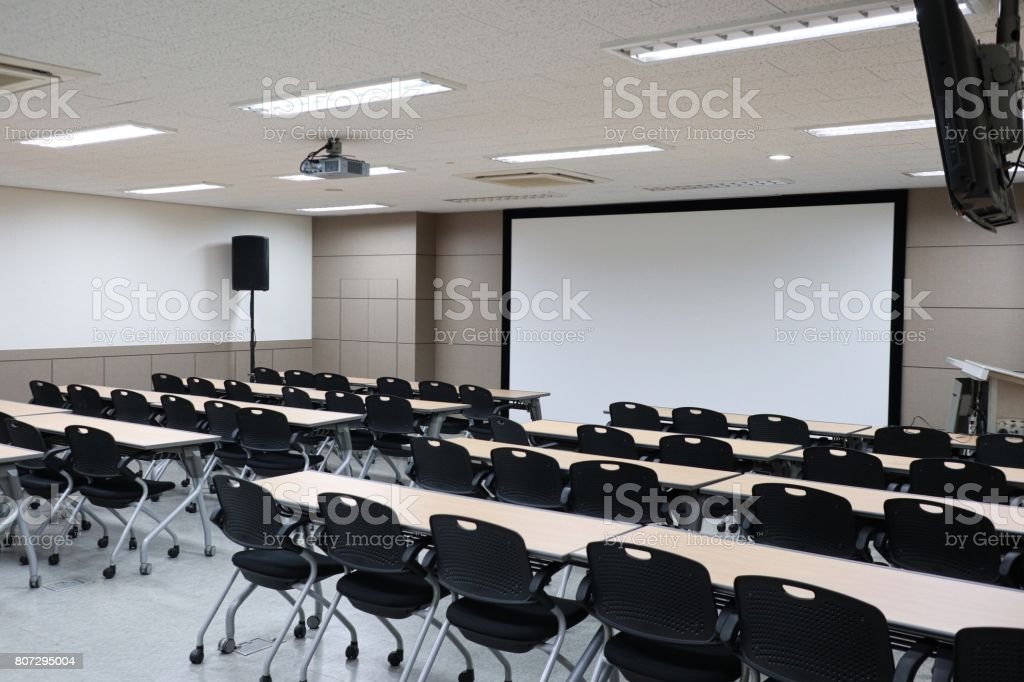 Lecture hall, Empty university classroom with two blocks of chairs stock photo