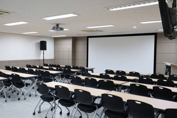 Lecture hall, Empty university classroom with two blocks of chairs Lecture Hall, Classroom, University, Campus, Desk lecture hall stock pictures, royalty-free photos & images