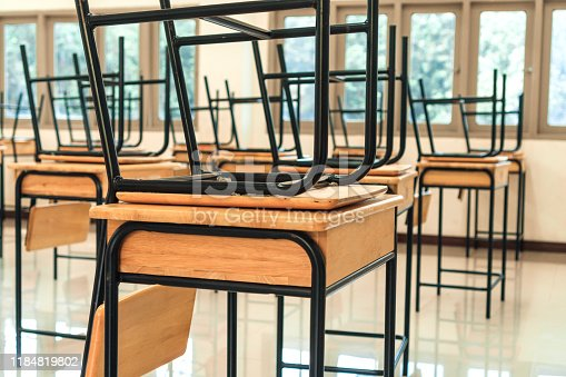 1047047834 istock photo Lecture room or School empty classroom with desks and chair iron wood in high school thailand, interior of 1184819802
