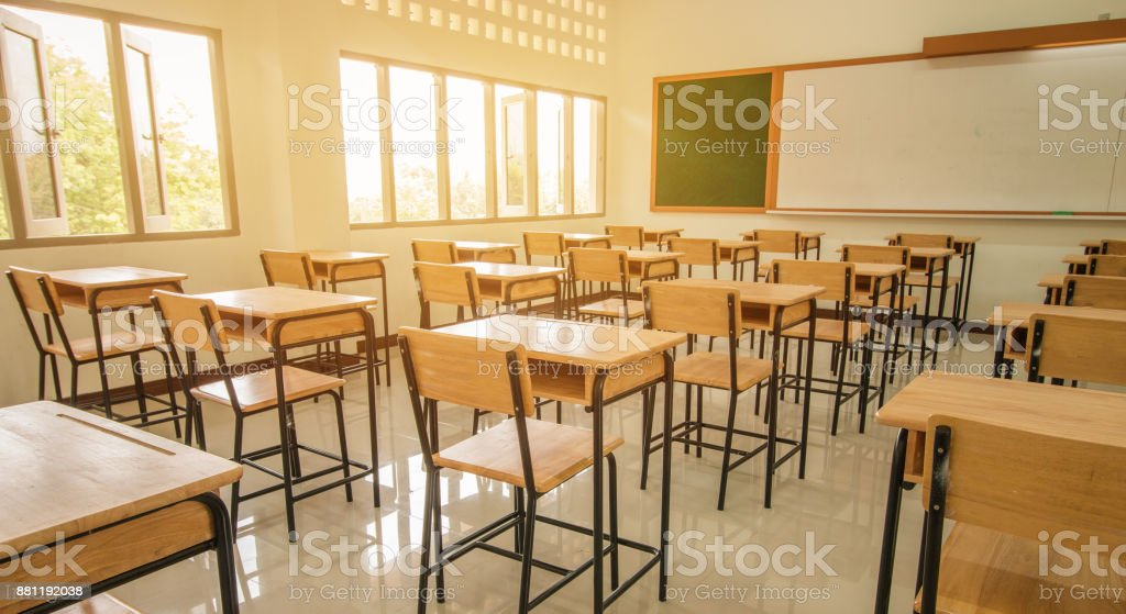 Lecture room or School empty classroom with desks and chair iron wood for studying lessons in high school thailand, interior of secondary education, with whiteboard, vintage tone educational concept stock photo