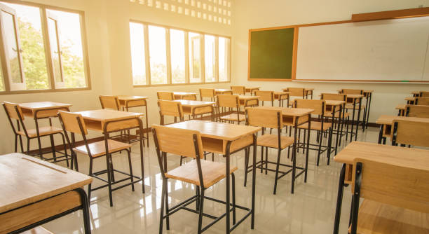 lecture room or school empty classroom with desks and chair iron wood for studying lessons in high school thailand, interior of secondary education, with whiteboard, vintage tone educational concept - school building stock photos and pictures