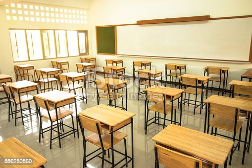 1047047834 istock photo Lecture room or School empty classroom with desks and chair iron wood in high school thailand, interior of 886280860
