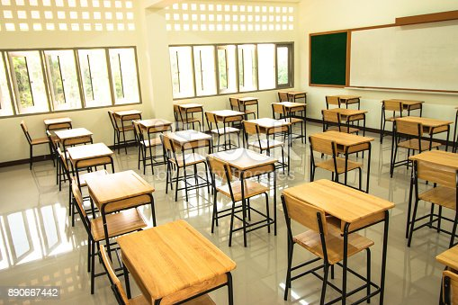 1047047834 istock photo Lecture room or School empty classroom with desks and chair iron wood in high school thailand, interior of 890667442