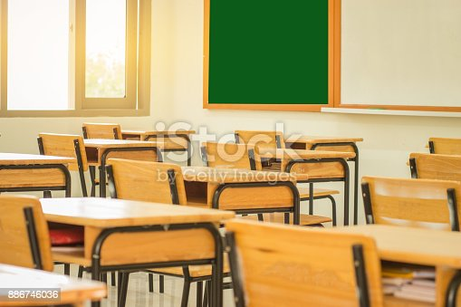1047047834 istock photo Lecture room or School empty classroom with desks and chair wood in high school thailand, interior of  secondary education, educational concept 886746036