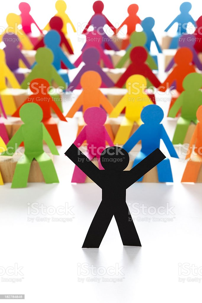 Lecturer expanding in front of crowd - paper concept royalty-free stock photo