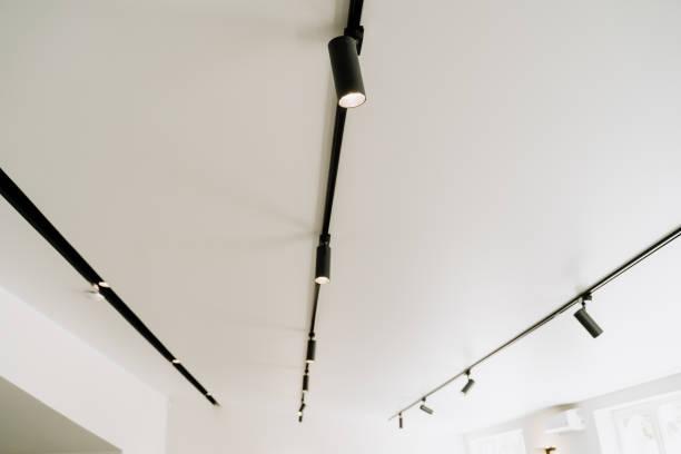 Led Black Spot Light on White Ceiling stock photo