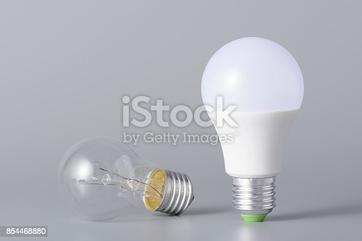 istock Led lamp and incandescent bulb 854468880