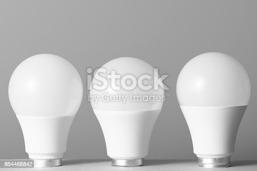 854468792 istock photo Led light bulbs on gray background 854468842