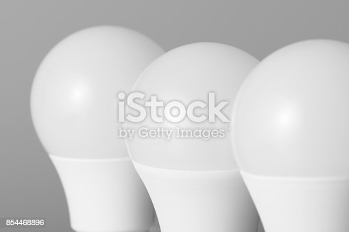 854468792 istock photo Led light bulbs on gray background 854468896