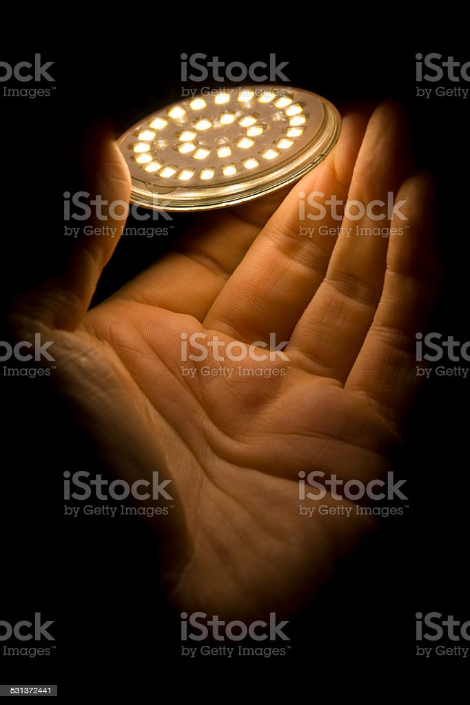 Led Light in hand XXXL stock photo