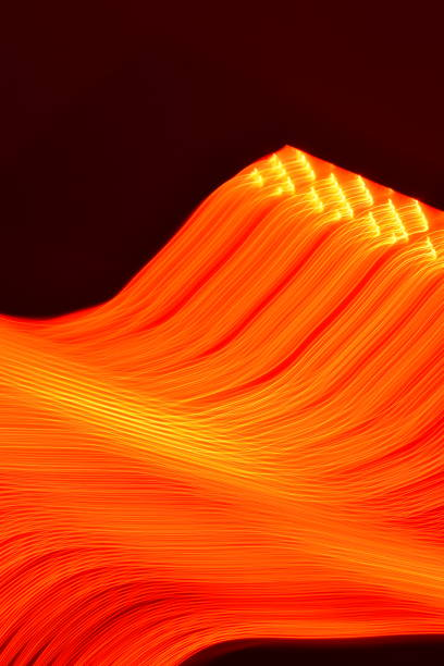 led light trails orange bar graph - steven harrie stock photos and pictures