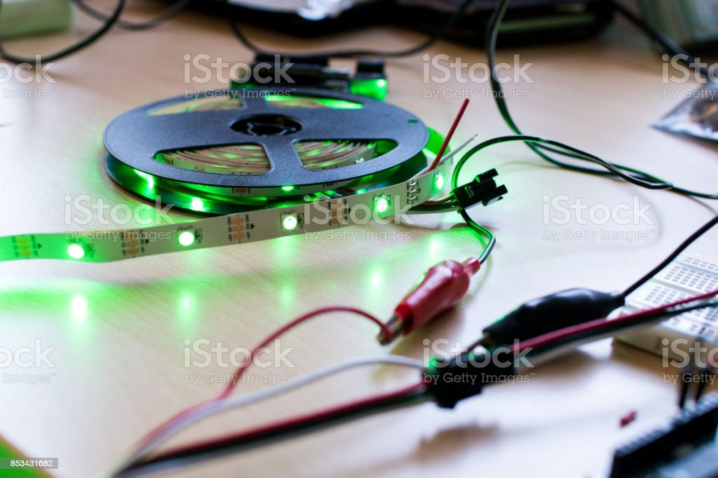 RGB led strip addressable controlled by a microcontroller open source to have green color flux. RGB led strip addressable controlled by a microcontroller open source to have green color flux. Maker project for DIY environment lighting. Lights for wearable Business Finance and Industry Stock Photo