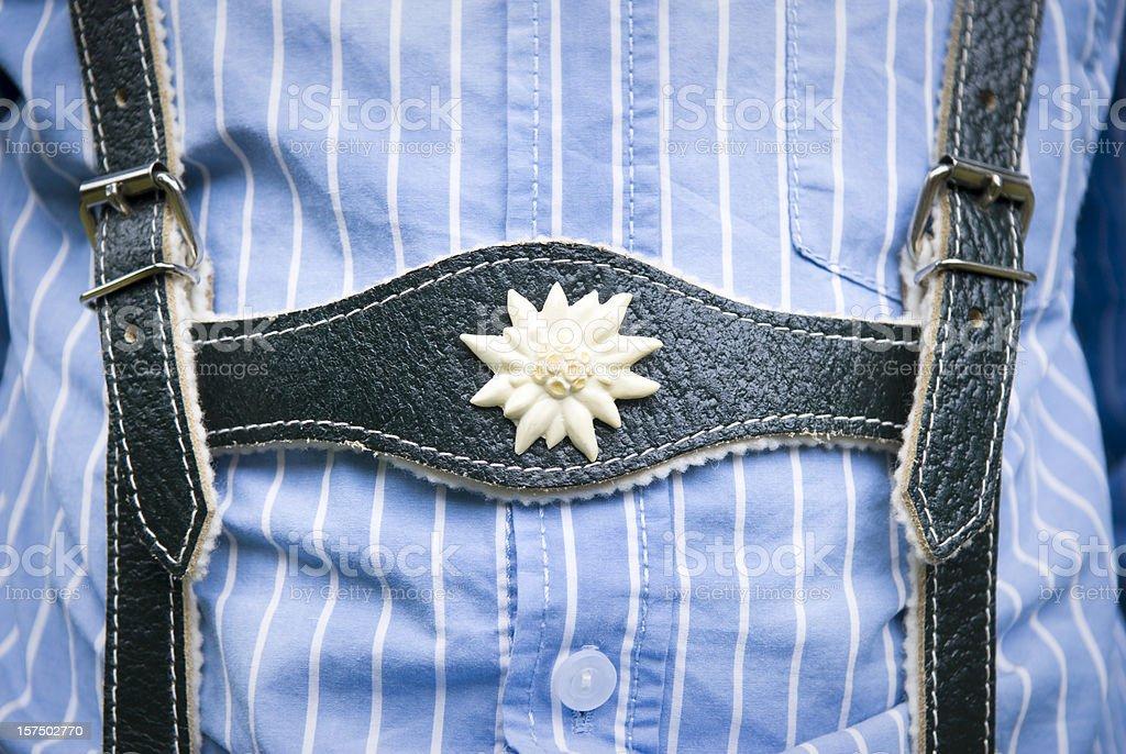 Lederhosen close-up, young boy wearing them and blue striped shirt stock photo