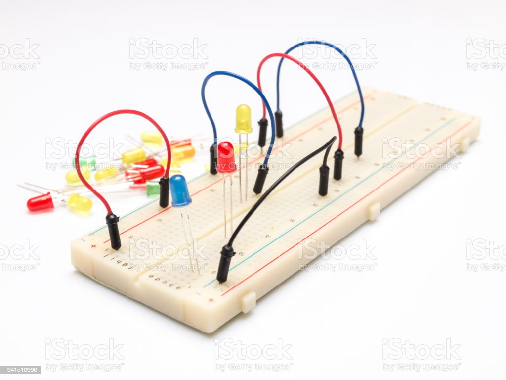 Leds And Cables On Prototype Table Isolated White Background Capacitors Resistors A Circuitbreadboard Wires Batteries Royalty Free Stock Photo