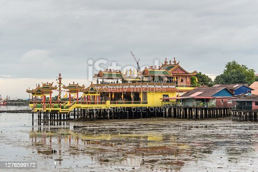 George Town, Penang, Malaysia - December 1, 2019: Lee Clan Jetty view during low tide and cloudy weather in George Town, Penang, Malaysia. The Lee Jetty housed the people of the Lee clan.
