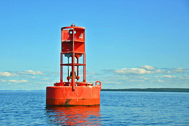 Lee Point Buoy Buoy marking Lee Point in Grand Traverse Bay near Traverse City Michigan. buoy stock pictures, royalty-free photos & images