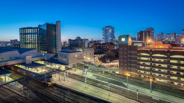 Leeds cityscape and skyline at night showing offices, apartments and railway station stock photo
