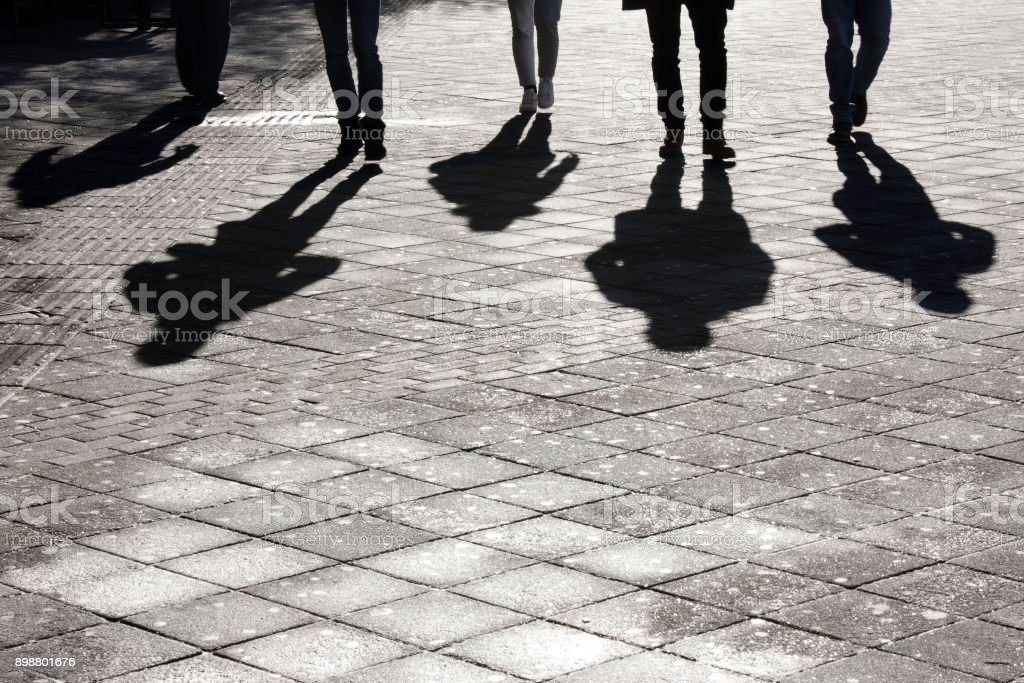Leegs and shadow of five people royalty-free stock photo