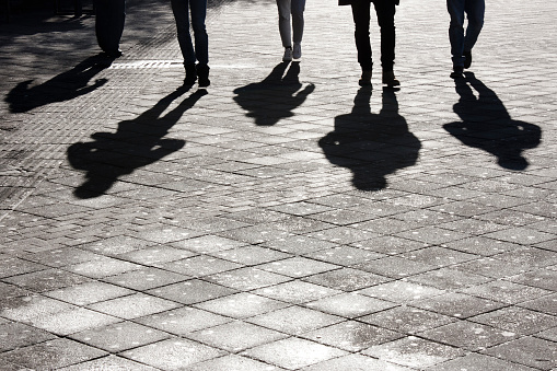 Leegs and shadow of five people