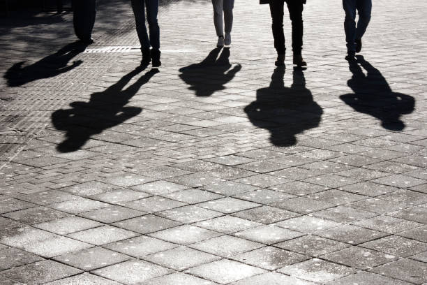 Leegs and shadow of five people stock photo
