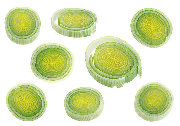 Leek round slice collection Leek round slice set isolated on white background leek stock pictures, royalty-free photos & images
