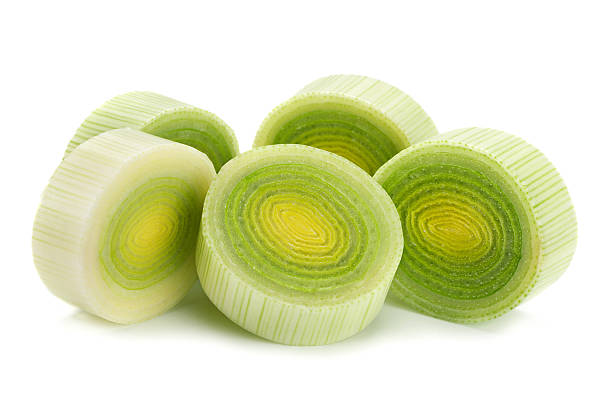 Leek vegetable on white Leek vegetable closeup isolated on white background leek stock pictures, royalty-free photos & images