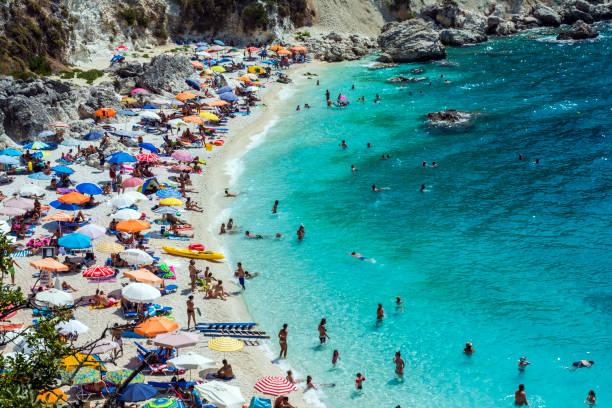 Lefkada island, Agiofilli beach, Greece. Summer holidays, many people on the beach, sea swimming stock photo