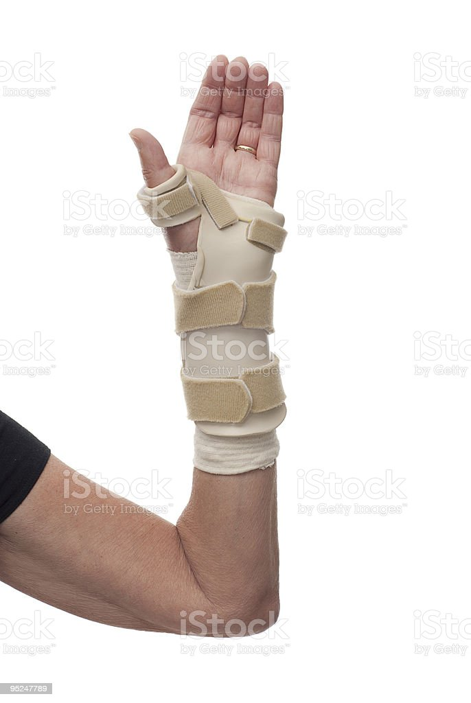 Left arm and hand in bandage plus brace, palm up royalty-free stock photo