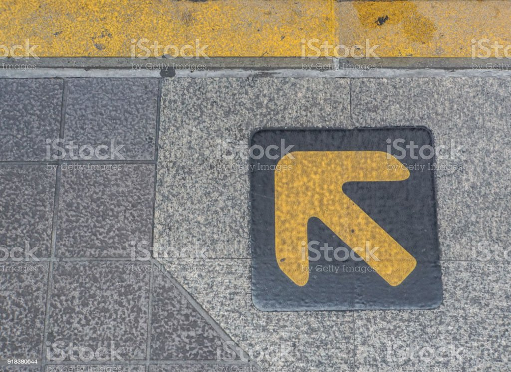 left arrow direction on queue at BTS sky train stock photo