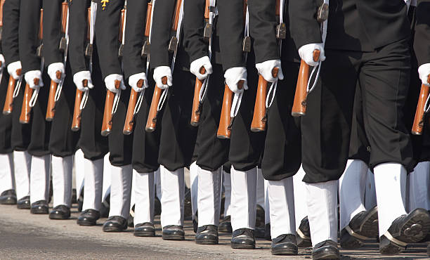 Left Foot Forward Sailors of the Indian Navy marching in step at the annual Republic Day Parade in Delhi, India military parade stock pictures, royalty-free photos & images
