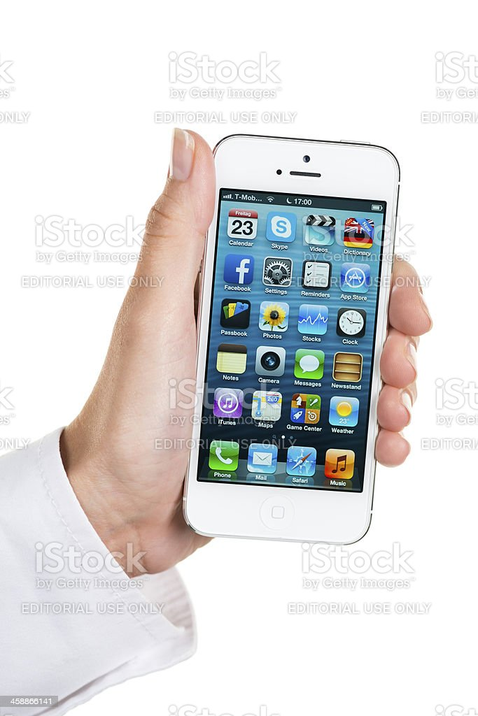 Left hand holding iPhone 5 royalty-free stock photo