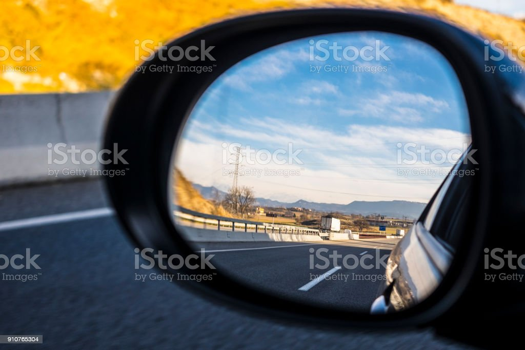 Left mirror car on a highway on a blue sky stock photo