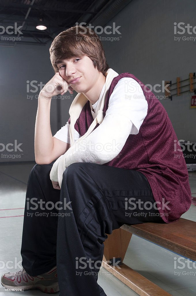 Left Out: Injured Boy on the Bench royalty-free stock photo