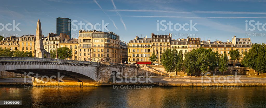 Left Seine river bank bathed early morning summer light. stock photo