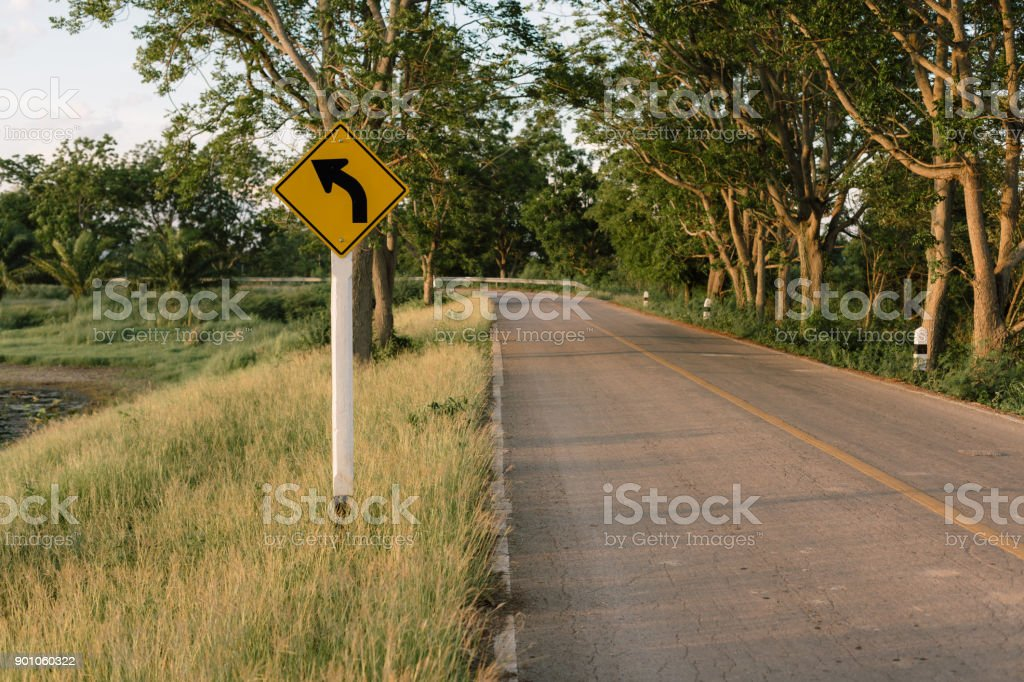 Left Turn Sign, Road sign warns of a left turn stock photo
