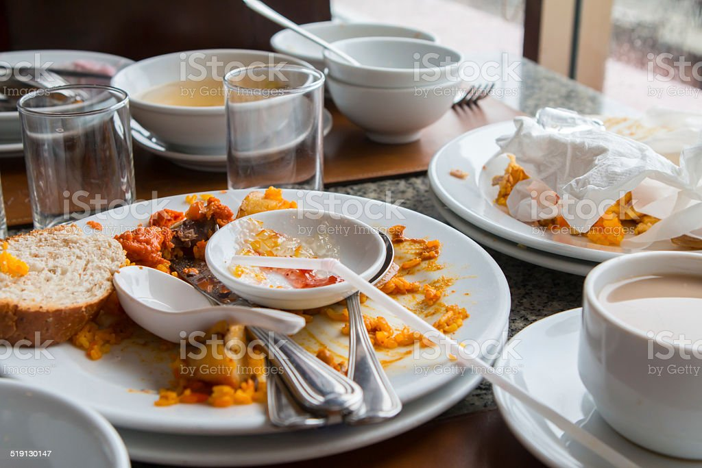 Leftover food on the table. stock photo