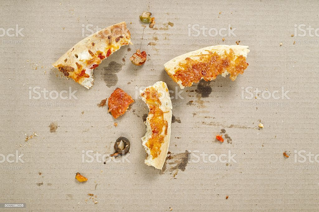 leftover pizza crust heel stock photo
