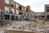 istock Leftover remnants of an abandoned red brick factory left to rot 1151594463
