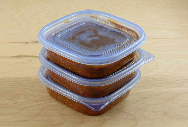 Leftover spaghetti sauce Batch of freshly made spaghetti sauce with ground turkey meat in plastic storage containers to prepare for freezer and meals in advance for work week leftovers stock pictures, royalty-free photos & images