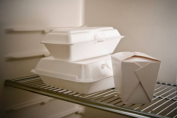 Leftovers Again Take Out Food Three take out or restaurant leftovers containers in refrigerator. Focus on the styrofoam containers leftovers stock pictures, royalty-free photos & images