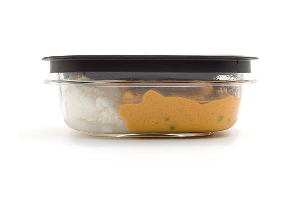 Leftovers for lunch Leftover curry and rice packaged up for lunch the next day leftovers stock pictures, royalty-free photos & images