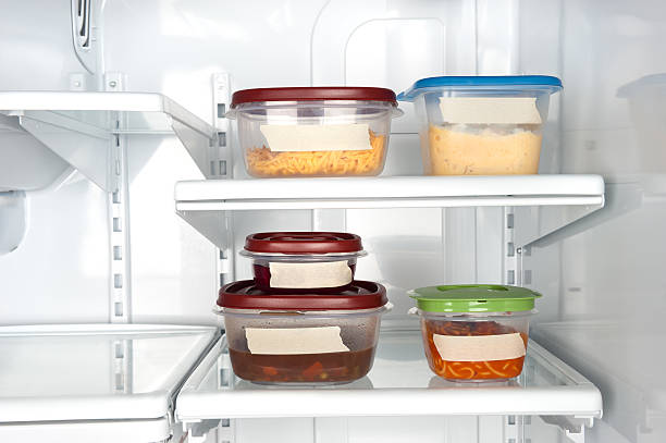 leftovers in tupperware - container stock photos and pictures