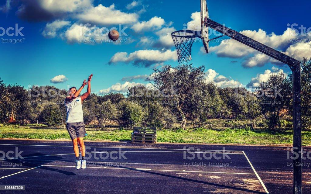 Lefty basketball player jump shot stock photo