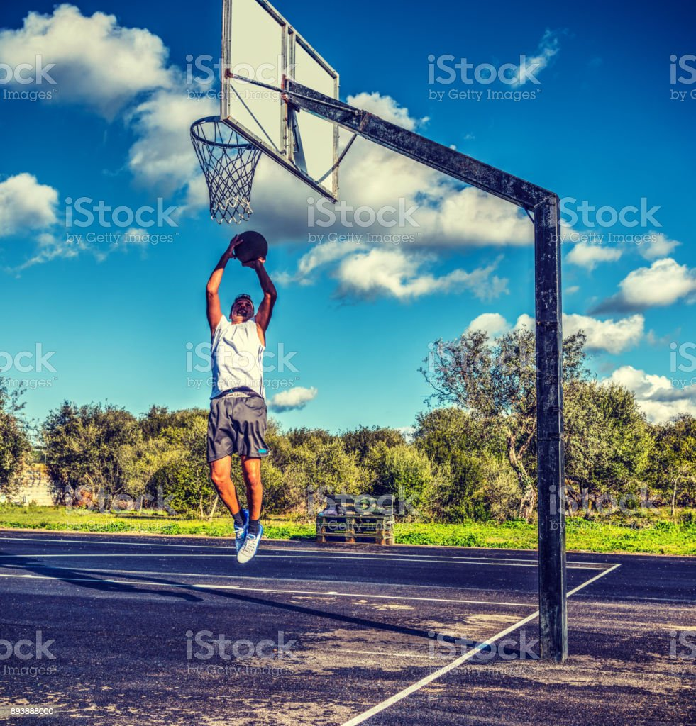 Lefty basketball player jumping in retro tone stock photo